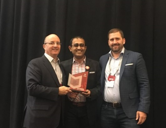 D.J. Long from McAfee presents the SIA Most Valuable Partner of the Year award to Ananth Appathurai and Matt Knutsen from Avecto